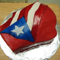 Puerto Rican Boxing Glove Made this chocolate boxing glove cake for a co-worker's Puerto Rican friend who really likes boxing. The icing on the glove is...