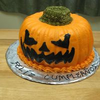 Scary Jack-O-Lantern Made this for halloween/birthday of someone from Puerto Rico. It's two chocolate bundt cakes put together with buttercream icing. I...