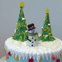 Snowman Cake   Buttercream covered cake with fondant and gp accents