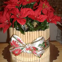 Poinsetta Cake. This was a quick cake I made for a friend. It was vanilla cake with barbarian cream filling and covered in BC. These are silk flowers and...