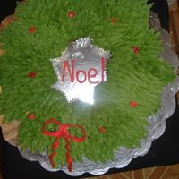 Wreath Cupcake Cake. These were chocolate and vanilla cupcakes put together to make a shape of a wreath and did lots of piping as you can see. Hope you enjoy it...