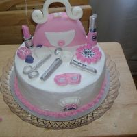 Girls Make-Up Theme This was for a 7 yr old having a nail/make-up party theme. Cake is covered in buttercreme and the rest is in bubble-gum flavored fondant. I...