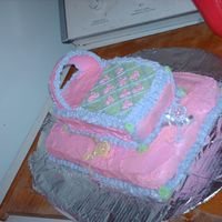 Cradle In Waiting  I made this cake for my oldest daughter's baby shower. Done mostly in pinks because we knew we were expecting a girl. The design is...