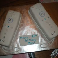 Wii Remotes two Wii remotes for a co-worker's brother. had a blast making them. they are rum cake underneath.