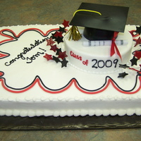 Red/black Graduation Cap buttercream with black and red fondant accents. Cap made from fondant.