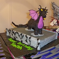 Maleficent From Sleeping Beauty Cereal treat dragon covered in modeling chocolate. I made the wings out of gumpaste.