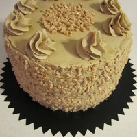 Pumpkin Toffee Cake Pumpkin cake with toffee cream filling and caramel buttercream frosting.