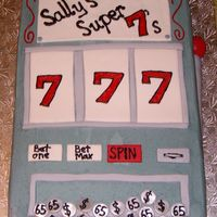 Lucky 7's   Slot machine cake for a 65th birthday, hence the coins. Buttercream with fondant accents.