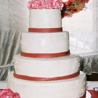 Tamyra's Cake  My sister's wedding cake. 6, 9, 12, 15 inch rounds iced in Indydebi's buttercream with piped triple swiss dots, fondant ribbon,...