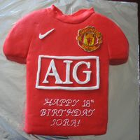 Manchester United Jersey made with fondant. Crest was rice paper painted and applied to thin fondant. The birthday boy loved this cake,