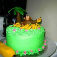 Monkey Birthday WASC, with buttercream and fondant figures. Inspired by the pile of bananas cake on CC.The large banana is twinkies covered in fondant to...