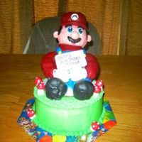 Super Mario Wasc. Buttercream and fondant on Mario and mushrooms.