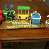 Circus Train this started as a 12 x 18 sheet cake that was cut up into 4 x 6 portions and used different layer amt for each car. also had 6 in round...
