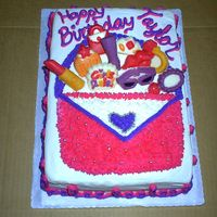 Taylor's Purse Cake Made this for a friends dtr. Spent more time doing the chocolates than I did the cake I think. She loved it.