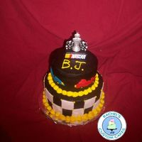 Race Car Cake French Vanilla Cake, Chocolate Fudge Frosting & Filling, Fondant Accents. 6 & 8 inch tiers. Serves 20.