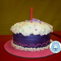 Whimsical Cupcake This was a huge cake! 4 - 12x2 inch round cakes carved, then lots and lots of buttercream frosting. Fondant candle and plaque. It was so...
