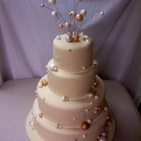 "Champagne Bubbles Wedding Cake We copied this unique cake from a magazine that the bride gave us. It is covered in fondant and the ""bubbles"" are gumpaste."