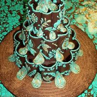 Chocolate Paisley coconut cake covered with chocolate ganache. decorated with chocolate candy melts that were melted and shaped on flower formers.