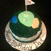 "Golf Cake  10"" round red velvet cake covered in cream cheese icing and then covered in fondant. Argyle pattern and golf green is fondant as well..."