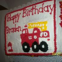 Firetruck Cake   This is for a little boy's birthday. It is yellow cake with strawberry filling and buttercream icing
