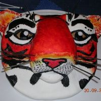 Tiger Cake   This was for my older bro's 29th b'day...it didn't come out as well as i had hoped but it still looks ok