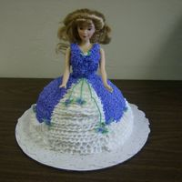 My First Doll Cake.  This was a real cool cake to make, the best part is that i shaved the cake myself, it was actually a square cake, i didn't have time...
