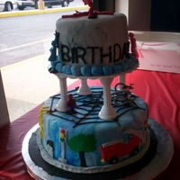 Spiderman, Street Scene, And Power Ranger Cake I am new to cake decorating and this is my first real cake that I made, 2 tier. Marbled blue and white fondant on the bottom with fondant...
