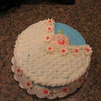 Baby Shower Carriage 10 inch cake made with BC with gumpaste flowers with the basket weave carriage. Since I am new, this fun to make. I love doing this!!! And...