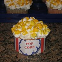 Popcorn Cupcake  Popcorn cupcake made for my son's daycare. The marshmallows were cut in half and stuck back together. Then they were stuck on the iced...