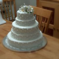 My Very First Wedding Cake! This is my first wedding and tiered cake. It was for my little sisters wedding. I had trouble getting the icing really smooth but she loved...