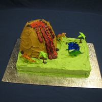 Volcano Cake I made this cake for a boy's sixth birthday. He loved it. It is a cake baked in a bowl on a 9x13 cake. I made the rocks out of fondont...