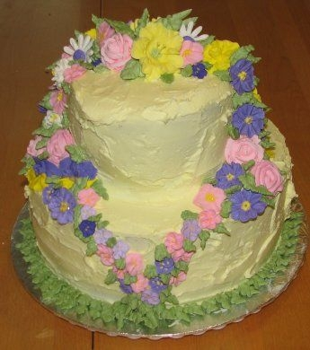 Yellow Cake With Flowers I did this cake for my friend's 40th birthday. I used the royal icing flowers that we made in the second Wilton class and a couple...