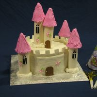 Castle Cake My daughter's 6th birthday cake. I got the idea from the 2hr cake book. The cake is fondant with a brick pattern rolled onto it. The...