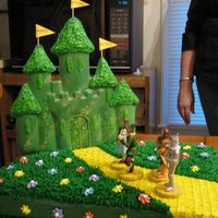 Wizard Of Oz This is a cake I made for a 3yr olds Bday. The castle is made with green wilton melted candies in the enchanted castle cake pan. I melted 3...