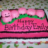 Pink Snowball And Black Catapillar Cake Mother found a catapillar in bright basic color and wanted it in pink and black for the one year old's birthday. We took choc covered...