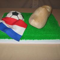Dutch Groom's Cake  The groom was a soccer fan and also from the Netherlands. He wanted something with a soccer ball, the Netherlands flag, and his wooden...