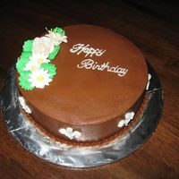 Chocolate Bday Cake Golden Butter Cake with Bavarian Chocolate filling and Chocolate buttercream. Flowers were left over from a Royal Icing flower class (so...
