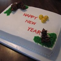New Year Pinecones Yellow cake with bc frosting and bc pinecones. Super simple cake and design.