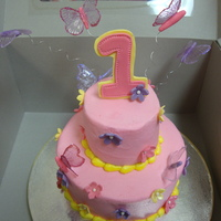 "1St Birthday Light pink buttercream cake, 6"" and 3"" cake with gelatin butterflies and gumpaste topper and flowers!! It was really fun to make..."