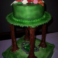 Flowers In The Trees Handmade chocolate flowers top this tree cake with pond below.