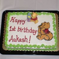 Pooh 1St Birthday  This is my first ever bct!!! I messed it up a little but i don't think anybody noticed. the cake was a 2 layer yellow cake with...