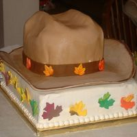 Cowboy Hat My first cowboy hat! It was for a groom's cake and she wanted to incorporate fall leaves. Thanks to thecakemaker for all of her help...