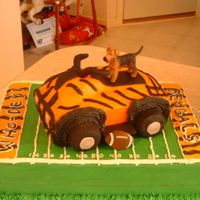 Groom's Cake This was a fun cake - I was told to incorporate the Bengals, 4wheeler and a Schnauser (the engaged couple's first baby whose name is...