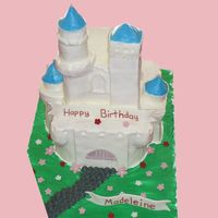 Castle I made this based of a pic the mother gave me of a porcelain castle. I did the best I could to match. It is all cake with buttercream icing...