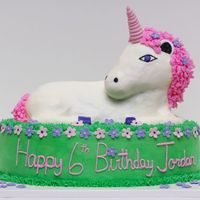 Jordan's Unicorn Made from the 3D lamb pan. White cake covered in buttercream with fondant flowers and fondant horn. Directions can be found at the Wilton...