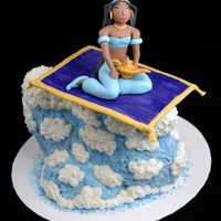 Jasmine On A Flying Carpet Jasmine and the carpet are sculpted from a mixture of gumpaste and fondant. The cake was the 3D duck pan with part of the head chopped off...