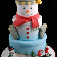 Snowman Hat Box My other entry in the OSSAS. It made 1st in the adult advanced Holiday category. Covered in fondant with fondant/gumpaste characters. The...