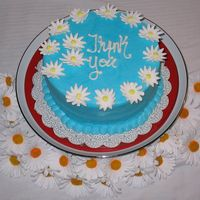 "Daisy ""thank You"" Cake  This was a last minute cake I did for our realtor for being so nice to us. It turned out darker than I wanted. You know how buttercream can..."