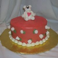 Bear Valentine This is an Italian Cream cake with buttercream icing. Fondant bear and flowers.