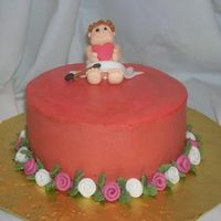Cupid Valentines Pink Champagne cake with buttercream frosting. Fondant cupid and flowers